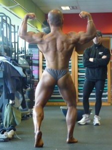 "Back Double Biceps - few days out from the Australian Natural Bodybuilding Championships Result: 2nd in Australia. Here, you can see the ""x-frame"" and shoulder boulders in action. Takes years of focused work."