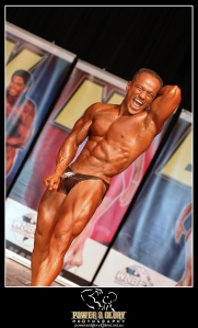 In the heat of competition.  Pose name: Abdominal/Thighs. Place in contest: 1st.