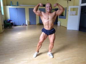 "Front double biceps - a week ago. Practice. ""Practice does not make perfect. Perfect practice makes perfect."""