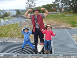 With my children striking a 'front-double biceps' pose for the camera. Watch out these guns are loaded .... hope you're wearing your bullet-proof vests! Vv.