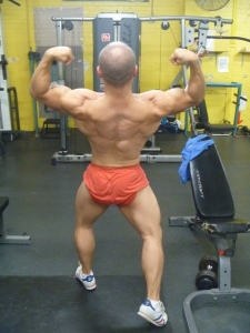 Back double biceps in the gym. Practise posing in the gym is important for enhancing that 'muscle-mind connection'. Vital for growth and progress. Increases your awareness of yourself.