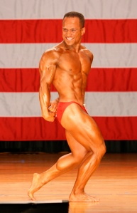 Side Triceps pose in the heat of competition at the 2007 World Natural Bodybuilding Contest held in NY, USA. Represented Australia. Ranked: 4th Best Natural Bodybuilder in the World. Repeated this in 2008.