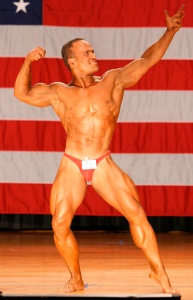 "A slight variation on the compulsory ""Front Double Biceps' bodybuilding pose. With this one ... I'd say you reach for the stars. Contest: 2007 World Natural Bodybuilding Championships held in NY, USA. Ranked: 4th Best Natural Bodybuilder in the World."