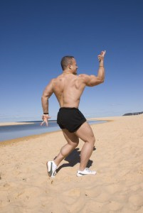 "A variation of the 'back single biceps"" pose ... on the beach. The combination of chaos + order = Life."