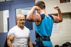 Brad improving his muscle control through a traditional body-building pose: double-biceps pose.  I believe it adds to muscle growth. It assists him in realising his body re-engineering goals.