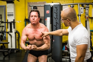 "Setting his own standards through -  Mind-muscle connection. 'flexing the muscles' in a ""most-muscular' pose.  Chris is an A+ student and the results show for a 47 year old man.  On his way to realizing  a physique and mind-set he imagines himself having. ... adopting my framework to body/mind re-engineering. Vv"