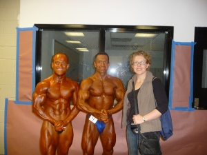 World Natural Bodybuilding Championships - New York, USA. Standing with middle-weight (my category) and overall World Champion. Me - 4th placed in the world Competitor beside me - 1st place and World champion Right: My Team Partner and wife - Cathy.